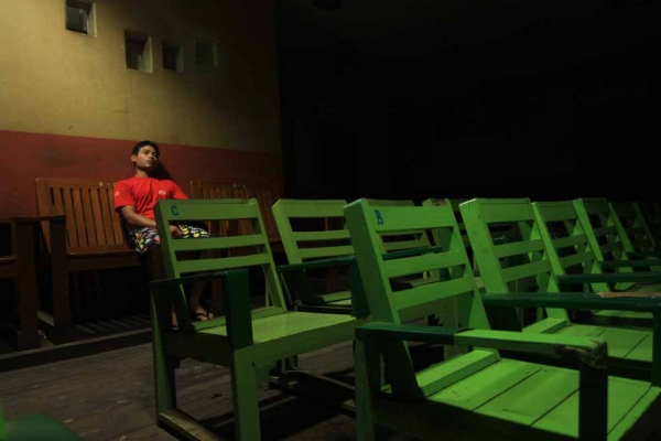 A lone viewer at the Aung Mingala Cinema in Dawei, Thanintharyi Division, Burma. (Philip Jablon)