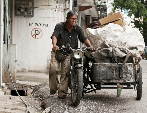 A cardboard collector in the back streets of Kuala Lumpur, Malaysia on May 15, 2012. (Photosightfaces/Flickr)