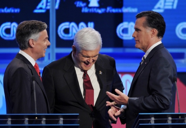 Jon Huntsman (L) confers with Mitt Romney (R) and Newt Gingrich (C) prior to the start of the Republican presidential debate on national security on Nov. 22, 2011 in Washington, DC. (Mandel Ngan/AFP/Getty Images)