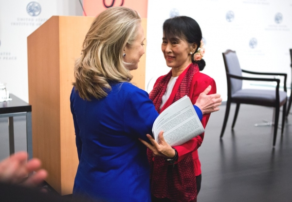U.S. Secretary of State Hillary R. Clinton greets Aung San Suu Kyi before the Myanmar parliamentarian spoke at the U.S. Institute of Peace in Washington, D.C., Sept. 18, 2012 (Asia Society/Joshua Roberts)