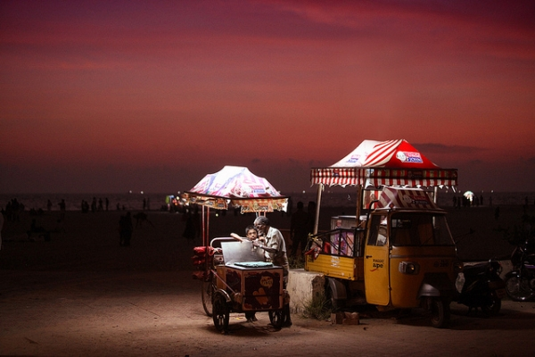An ice cream vendor mans his post on the Alleppey beach in Kerala, India on May 22, 2012. (VinothChandar/Flickr)