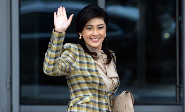 Thai Prime Minister Yingluck Shinawatra waves as she arrives to attend the Asia-Pacific Economic Cooperation (APEC) summit in Vladivostok, Russia on Sept. 8, 2012. (Saeed Khan/AFP/GettyImages)