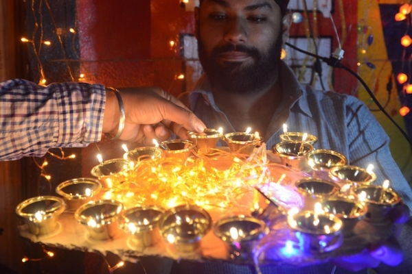A man holds up decorative oil lamps at a shop ahead of Diwali, the Hindu festival of lights, in Amritsar, India on November 6, 2012. (NARINDER NANU/AFP/Getty Images)