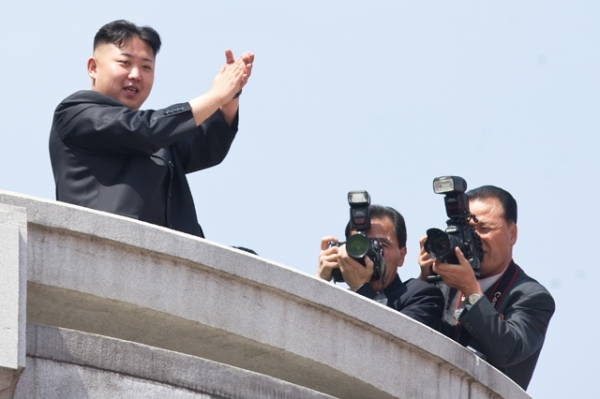 North Korean leader Kim Jong-Un (L) applauds during a military parade in honor of the 100th birthday of the late North Korean leader Kim Il-Sung in Pyongyang on April 15, 2012. (Ed Jones/AFP/Getty Images)