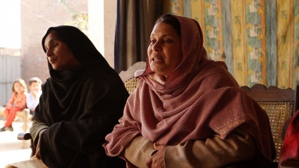 Poet and educator Rani Shameem Akhtar (R) leads a women's rights workshop in Malival, Punjab. (Andreas Burgess)