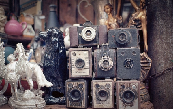 Vintage cameras are stacked with other knick-knacks in a shop in the Chor Bazaar in Mumbai, India on November 30, 2012. (Monkeypainter/Flickr)