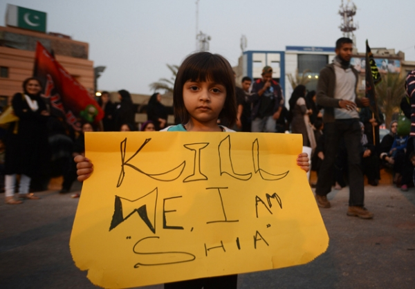 A Pakistani Shiite Muslim girl holds placard during a protest against the twin bombings in Quetta, in Karachi, Pakistan on January 13, 2013. (Asif Hassan/AFP/Getty Images)
