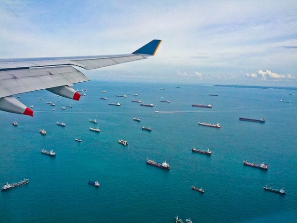Ships can be seen gliding on the water from an airplane window flying over the Strait of Malacca on January 21, 2013. (leogaggl/Flickr)