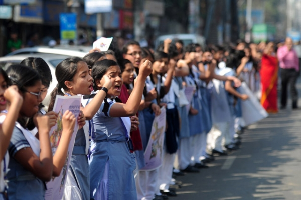 School girls form a human chain as they participate in a One Billion Rising rally in Dhaka, Bangladesh on February 14, 2013. (Munir Uz Zaman/AFP/Getty Images)