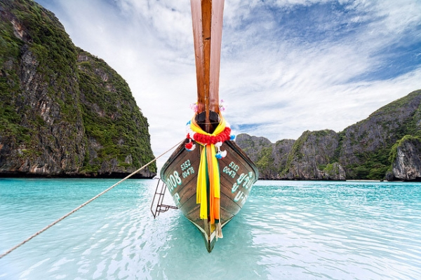 A long tail boat sits anchored at Maya Beach, Thailand on February 20, 2013. (efkarmanine/Flickr)