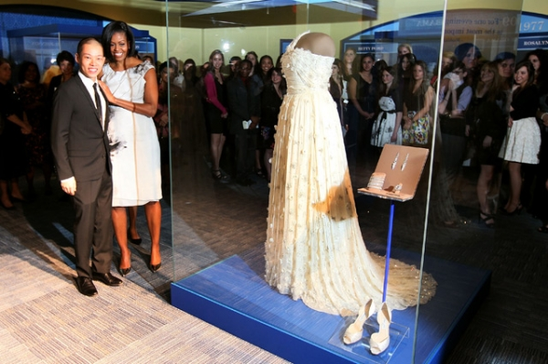 Michelle Obama stands with inaugural dress designer Jason Wu in front of the inaugural gown she wore to the inaugural balls and is now on display at the Smithsonian Museum of American History in Washington, DC  on March 9, 2010. (Mark Wilson/Getty Images)
