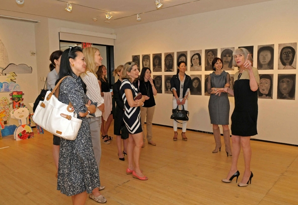 Head of Museum Education Programs Nancy Blume (R) leads a tour of the student exhibition. (Elsa Ruiz/Asia Society)