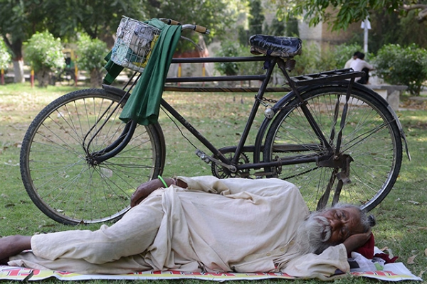 A man finds refuge in the shade during a heat wave in Amritsar, India on May 22, 2013. (Narinder Nanu/AFP/Getty Images)