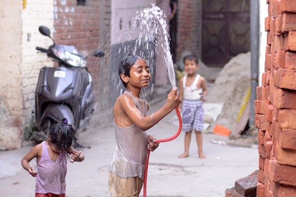 An Indian boy washes himself with water to cool down in Amritsar, India on May 28, 2013. (Narinder Nanu/AFP/Getty Images)