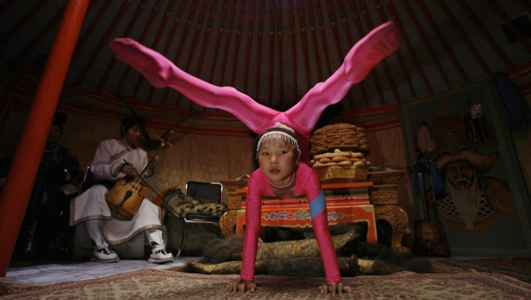 A 10-year-old Mongolian acrobat performs in the capital Ulaanbaatar during the annual Naadam Festival in July 2006. (Peter Parks/AFP/Getty Images)