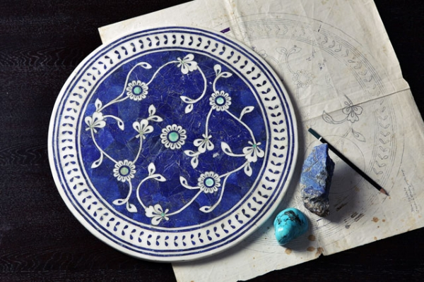 Peshawar-based company LEL works to preserve pietra dura, the art of handcrafted stone inlay, adhering to ancient techniques but with contemporary innovations. Above: Iznik filigree tabletop. (Omer Gilani@Happa Studio)