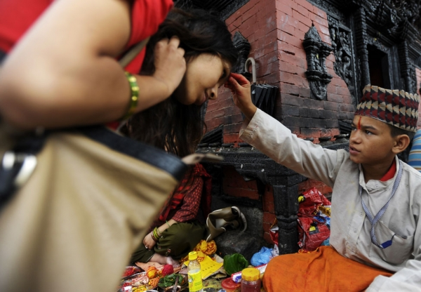 Further tika blessings for devotees at the Pashupatinath Temple in Kathmandu on July 22, 2013. (Prakash Mathema/AFP/Getty Images)