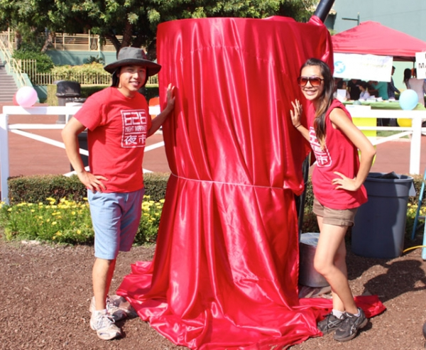 Albert Chu (L) and Patricia Huang (R) stand in front of Giant Boba Cup ahead of the unveiling ceremony at Santa Anita Park in Arcadia, California on August 3, 2013. (626 Night Market)