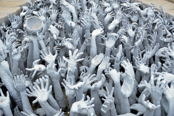 Grasping hands symbolize desire at the Wat Rong Khun Temple, also known as the White Temple, in Chiang Rai, Thailand on July 7, 2013. Construction is due to be completed in 2070. (Melissa Scott/Flickr)