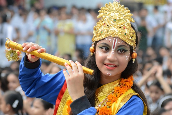 A pupil dressed as the Hindu god Krishna poses on the eve of the Janmashtami festival at a school in Amritsar, India on August 27, 2013. The Hindu festival of Janmashtami, which falls on August 28 this year, marks the birth of the Hindu god Lord Krishna. (Narinder Nanu/AFP/Getty Images)
