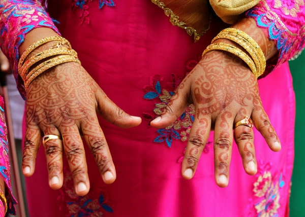 Traditional henna adorns a woman's hand in Singapore on September 2, 2013. (Edelman APACMEA/Flickr)