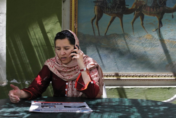 Kabul, 2010: Human rights campaigner Orzala Ashraf, working from the relative safety of the Kabul Cafe. (Abbie Traylor Smith/Panos)