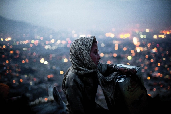 Kabul, 2009: A young Afghan girl atop one of the major hills over looking the city.  (Jared Moossy/Redux Pictures)