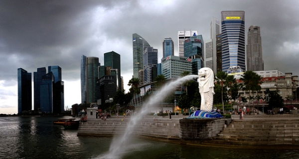 The Merlion is a mythical creature with the head of a lion and the body of a fish. Set against Singapore's skyline, the Merlion statue spouts water on November 14, 2013. (Gaelen/Flickr)