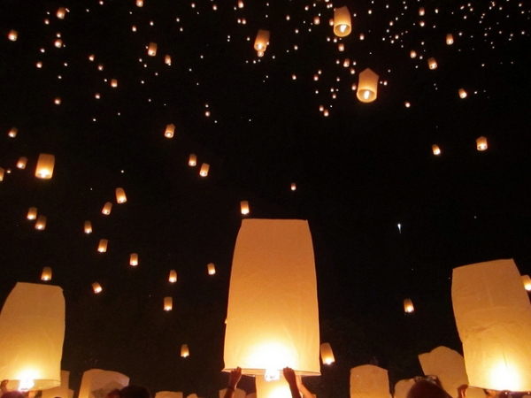 Hundreds of sky lanterns light up the night's sky during the Yi Peng Festival in Chiang Mai, Thailand on November 16, 2013. (shelmac/Flickr)