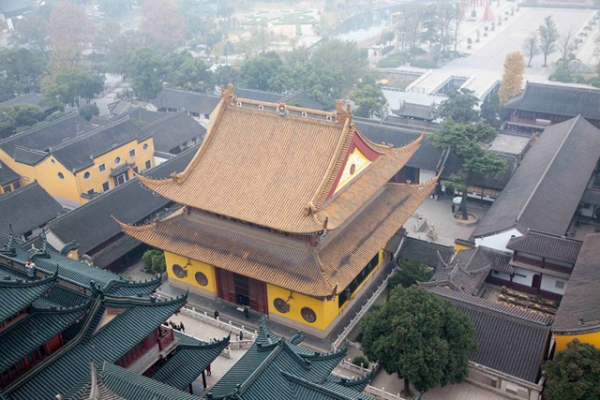 The yellow facade of a temple stands out from a view atop a building in Zhenjiang, China on December 6, 2013. (Tahiat Mahboob)