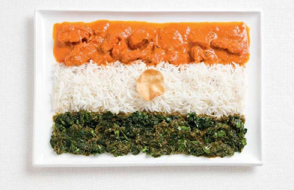 The Indian flag made from curries, rice, and pappadum wafer.