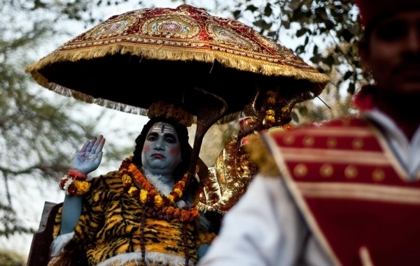 A devotee dressed as Hindu Lord Shiva takes part in a procession during Maha Shivaratri in New Delhi, India on February 20, 2012. (Manan Vatsyayana/AFP/Getty Images)