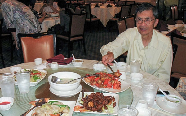Chinese food critic David Chan doing what he loves most. (Eric Chan)