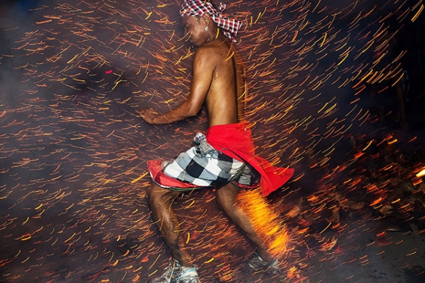 A Balinese man kicks up fire during the 'Mesabatan Api' ritual ahead of Nyepi Day in Gianyar, Bali, Indonesia on March 30, 2014. (Agung Parameswara/Getty Images)