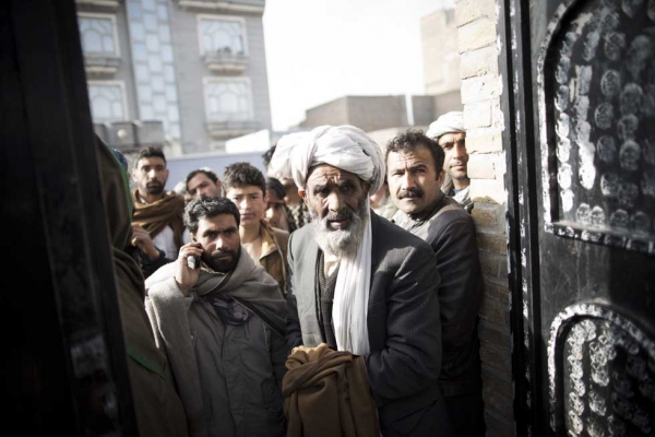 Afghans gather outside a closed voter registration center to try to receive their voter cards a day after registration ended for the forthcoming presidential election in Herat on April 2, 2014.  (Behrouz Mehri/AFP/Getty Images)