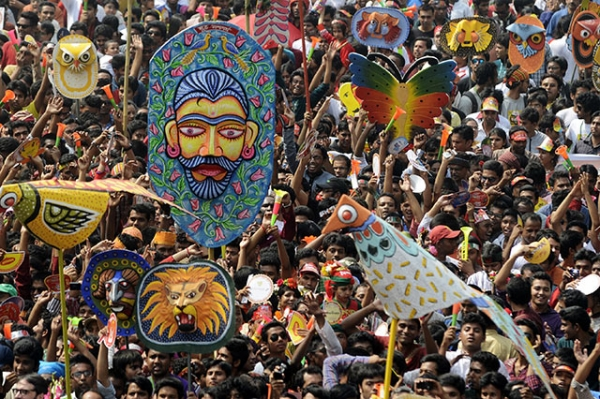 Bangladeshi revelers march during a rally in celebration of the Bengali New Year, or Pohela Boishakh, in Dhaka, Bangladesh on April 14, 2014.(Munir Uz Zaman/AFP/Getty Images)