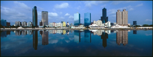 Buildings and people are reflected upside down in the water at Kaohsiung Love Pier in Kaohsiung City, Taiwan on April 15, 2014.