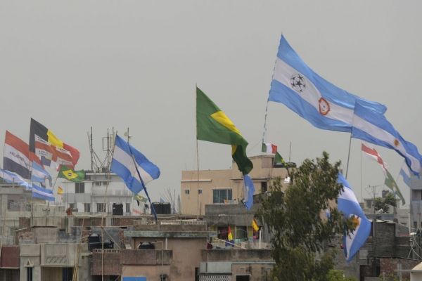 The national flags of countries competing in the FIFA World Cup are flown above rooftops in the Bangladeshi town of Bardi, northwest of Dhaka, on June 10, 2014. (Munir Uz Zaman/AFP/Getty Images)