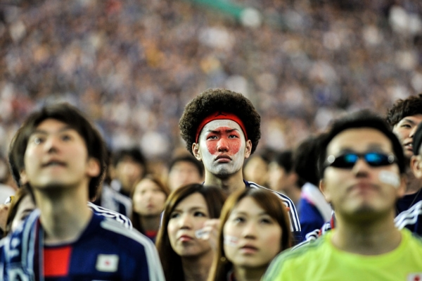 Japanese fans react after Japan is defeated during the 2014 World Cup match between Japan and Cote d'Ivoire during the public viewing event at Tokyo Dome on June 15, 2014. (Keith Tsuji/Getty Images)