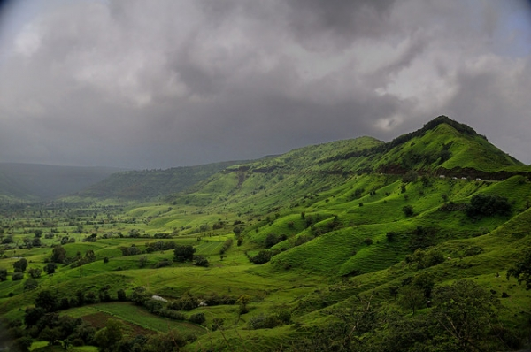 Storm clouds gather over the lush, green hills of the Konkan Coast in India on August 14, 2014. (Amit Rawat/Flickr)