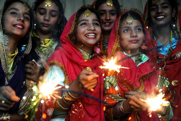 Indian schoolgirls share a light moment as they play with sparklers at a function in Amritsar on October 16, 2009, on the eve of the Diwali festival. (Narinder Nanu/AFP/Getty Images)