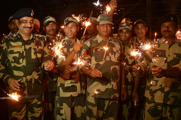 Indian Border Security Forces (BSF) play with sparklers to celebrate Diwali along the India-Pakistan Rajatal border post, about 45 kilometers from Amritsar, on October 23, 2014. (Narinder Nanu/AFP/Getty Images)