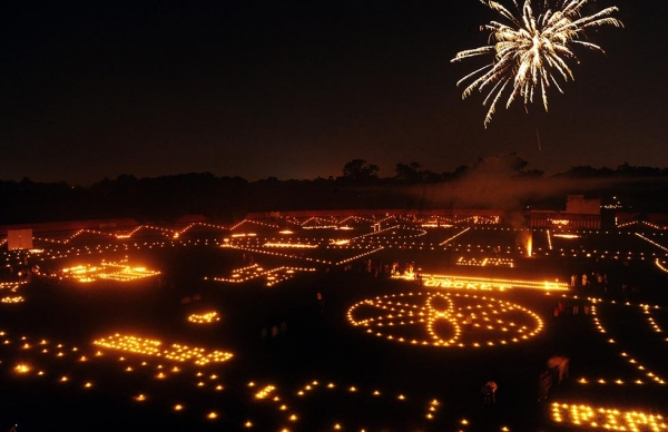 Indian residents light candles and lamps at the Madan Mohan Malviya stadium on the eve of the Hindu festival Diwali in Allahabad on October 22, 2014. (Sanjay Kanojia/AFP/Getty Images)
