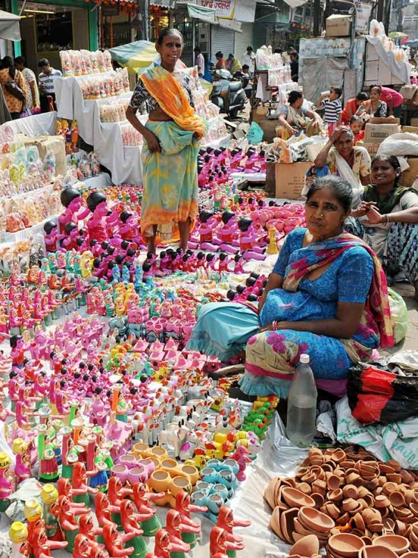 Indian street vendors sell earthenware lamps, gifts, and decorative items for the forthcoming Hindu festival of Diwali at a busy marketplace in New Delhi on October 15, 2009. (Raveendran/AFP/Getty Images)