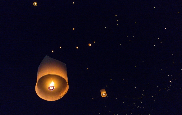Twinkling lanterns float into the night sky during the Yi Peng Festival in Chiang Mai, Thailand on November 25, 2015. (Klim Levene/Flickr)