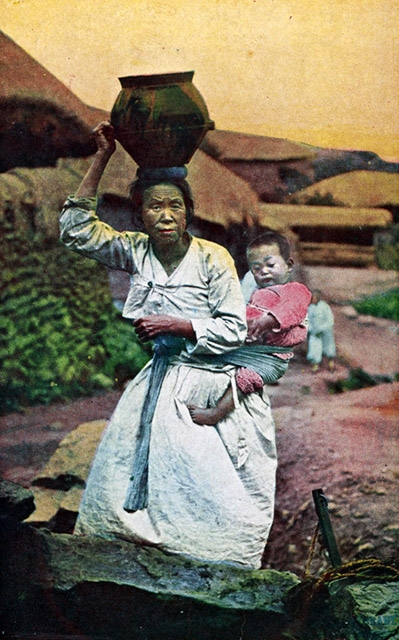"""Woman carrying water jar and baby."" (Hinode Shoko/New York Public Library)"