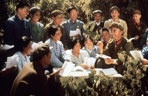 "Chinese youth with Red Guards study copies of Mao Zedong's ""Little Red Book"" in a picture released in 1971 by the official Chinese Xinhua News Agency. (STR/AFP/Getty Images)"