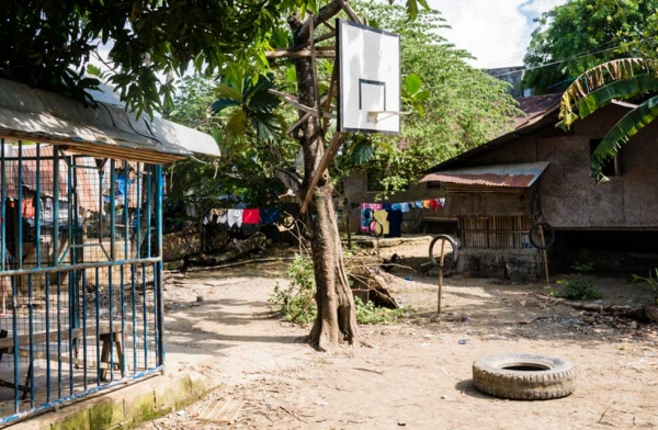 In a Catholic country like the Philippines, there are probably more hoops than churches. In this image, a single hoop is the focal point of a local village next to a small provincial chapel on the left. Cebu, Philippines. (Richard James Daniels)