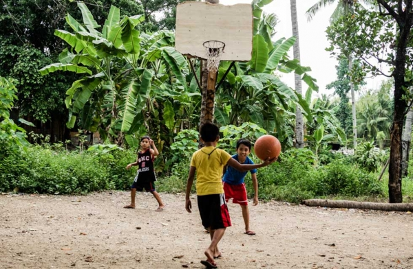 In the local villages, most children and adults play in just flip-flops. Cebu, Philippines. (Richard James Daniels)