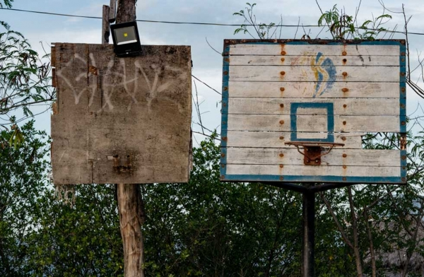 A hoop shifts from a makeshift backboard to a more upscale version. Many of the hoops that I have documented will disappear as the Philippines becomes more affluent. Cebu, Philippines. (Richard James Daniels)